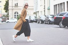 Blogger modelovers with a camel coat, Stan Smith Sneaker, Zara Culottes, an and other stories silk blouse and a Chanel sunglasses