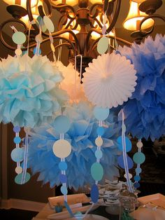 Chandelier display made from tissue paper, paper fans and garland made from paper circle punches and ribbon