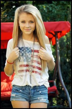 I want that shirt. I like wearing my Country's flag. I think this outfit would look so much cuter if her necklace was a bear instead of a jaguar, to symbolize Calfornia.
