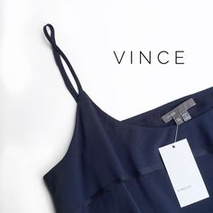 • vince navy top • in new with tag condition. the material is a silk blend. the Vince tag is beginning to fall off. Vince Tops Tank Tops
