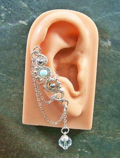 Customizable Silver Ear Cuff with Chain & Crystal (Choose Stone). $24.99, via Etsy.