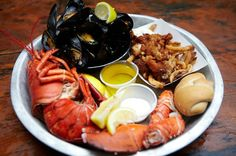 The Best Seafood Restaurants in Toronto- lobster, mussels, clams, and drawn butter