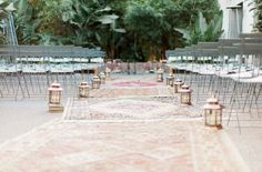 Love this vintage rug-lined aisle