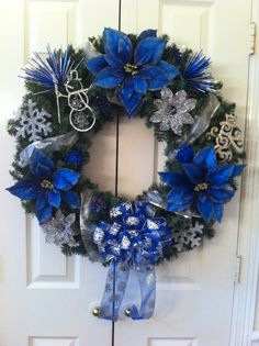 Blue & silver Christmas wreath by Katie Bryson Blue Christmas Decor, Hanukkah Decorations, Christmas Decorations For The Home, Christmas Colors, Christmas Holidays, Christmas Ornaments, Christmas Mantles, Christmas Villages, White Christmas