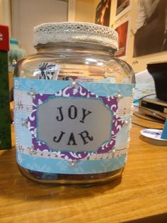 The memory jar that I made for Chelsea's secret santa gift :) fill with favorite quotes, inspirational messages, and happy memories written on the white side of scrapbook paper and folded so the patterned side shows. I also added some of those gem stones to the bottom for extra color.