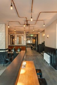Like the lights....maybe galvanized pipe? De Ebeling is one of the most famous 90s cafes in Amsterdam. The design is based on the style of …