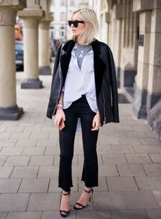 Contrast a formal blouse and trousers pairing with a tee layered underneath and leather jacket on top.