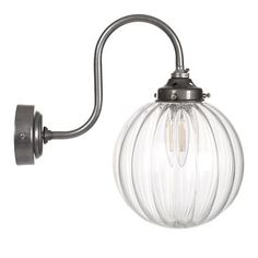 A beautiful wall light, with elegant curves combined with a beautiful spherical fluted glass shade. Suiting a period or modern home, others available in range Modern Bathroom Lighting, Modern Lighting, Window Furniture, Chimney Breast, Dressing Table Mirror, Led Candles, Hand Blown Glass, Glass Shades, Metal Working
