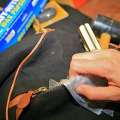 Use Wax Paper to Free a Stuck Zipper  Help the zipper on your tool bag slide along its track more easily by lightly running over the teeth with wax paper.