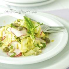 zucchini, yellow squash, radishes, pine nuts & capers in a salad w/ lemon-pecorino dressing
