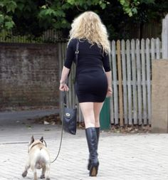 Sexy MILF walking the street with her dog wearing the clothes that are such a turn on. This, for me, is the perfect illustration of the older woman (or MILF as the common parlance goes.) A little desperate? Who cares? She knows how to work it...and HOW!! WOW!!. Great, sexy legs, high boots and stunning figure wrapped in a tight, black dress.