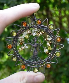 Amaterasu Japanese Sun Goddess Tree of Life Wire Wrapped Pendant Jewelry. My daughter bought this and it is even prettier in person. Wire Wrapped Pendant, Wire Wrapped Jewelry, Wire Jewelry, Pendant Jewelry, Jewellery, Crystal Jewelry, Beaded Jewelry, Handmade Jewelry, Bijoux Fil Aluminium