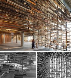 Lengths of reclaimed timber envelop the grand staircase that Melbourne office March Studio has created at the entrance to hotel Hotel in Canberra, Australia.
