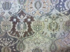 This is a woven wool carpet remnant with a floral pattern. This remnant came in our newest package on 9/15/2013 http://www.carpetworkroom.com