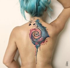 Watercolor spiral cover up piece with black ravens. Tattoo done by ...