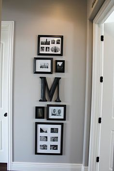 "gallery of frames, wall color Benjamin Moore ""Ozark Shadows"" lightened 50%."