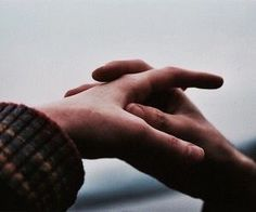 me folding my hands together to make it look like I'm holding someone else's hand