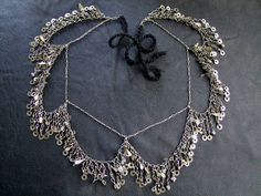 Make from kuchi chain and cut steel beads. <3