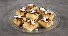 Syrupy coconut phyllo bites by the Greek chef Akis Petretzikis. Make easily and quickly this recipe for a scrumptious dessert with coconut and crispy filo! Greek Desserts, Greek Recipes, Raw Food Recipes, Asian Recipes, Nutrition Chart, Phyllo Dough, Processed Sugar, Good Fats, Baking Pans