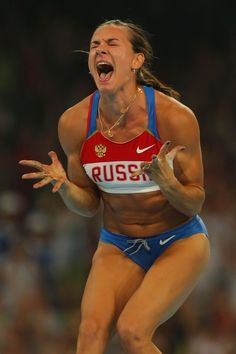 Inspirational Moments: Olympic celebrations - BEIJING - AUGUST 18: Elena Isinbaeva of Russia celebrates successfully jumping a new World Record of 5.05 in the Women's Pole Vault Final at the National Stadium on Day 10 of the Beijing 2008 Olympic Games on August 18, 2008 in Beijing, China. (Photo by Stu Forster/Getty Images)