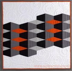 Tangerine Tumbler, by Mary Kay Fosnacht, in: Optical Illusions: Innovative Designs for the Modern Quilter.  Featured at My Stars Blog