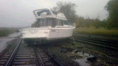 This photo provided by the Metropolitan Transportation Authority of the State of New York shows a boat resting on the tracks at Metro-North's Ossining Station in the aftermath of Hurricane Sandy on Tuesday, Oct. 30, 2012, in Ossining,N.Y. (AP Photo/Metropolitan Transportation Authority of the State of New York)