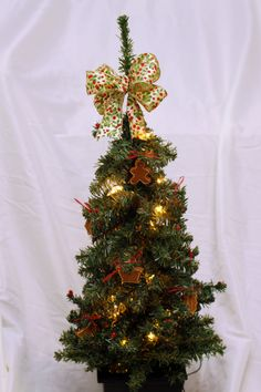 Pre-lit mini Christmas tree with homemade cinnamon ornaments