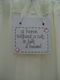 Handmade 'A home without a cat' wooden plaque on Etsy, £5.50