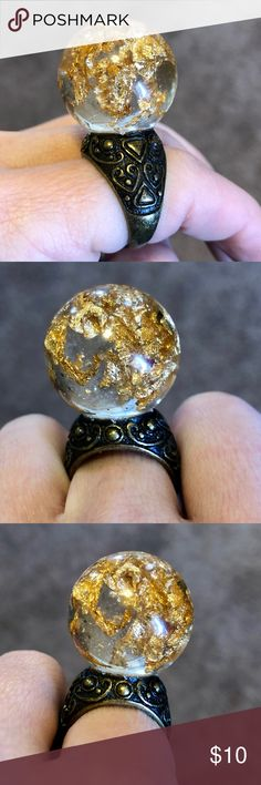 """Crystal ball ring sphere gold leaf jewelry flakes Beautiful Crystal Ball Ring of resin and gold flakes ! round Sphere """"Fortune Teller"""" gorgeous! It is made into a durable clear orb. This is a fixed size is about 7/7. 5 . Can be used as thumb ring.**Orbs has some bubbles from the formation process. Tags: dollskill unif Wicca Wiccan pentacle Telling Glass round stone Globe Goblin King Labyrinth witch healing scrying coven magic witch wand jewelry goddess occult killstar Quartz raw stone…"""