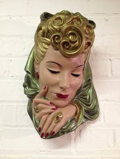 Vintage chalkware wall sculptures