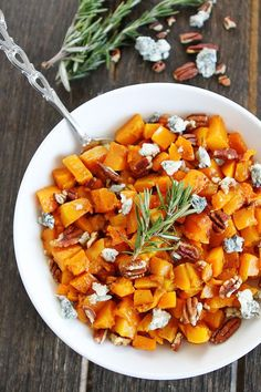 Roasted Butternut Squash with Balsamic, Blue Cheese, and Pecans Recipe on twopeasandtheirpod.com The perfect side dish for fall and all of your holiday meals!