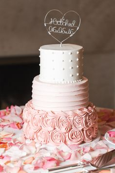 cream and pink wedding cake with frosting roses and polka dots at Lirodendron Mansion wedding
