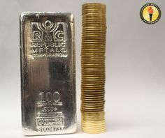 Stacks of #gold American Eagles high enough to pass this 100 ounce #silver bar! #moneymetals