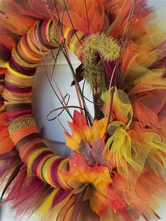Fall wreath amazingness with tulle and ribbon.  I can use the idea from @Cynthia Forry to make the wreath part!