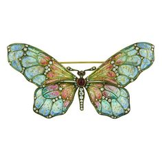Ruby, diamond, plique-à-jour enamel and gold butterfly brooch, circa 1880. Set with 90 diamonds and 3 cabochon rubies.