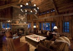 Like the luxe fabrics/leather on the furniture, Navajo weaving on the coffee table in this cabin living room.