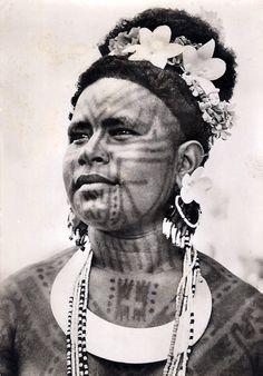 Papua New Guinea | Tattooed Rigo woman.  ca. 1944 - 1966 | ©Comet Press