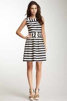 Stripes: Still in for the fall and what a cute way to wear them without looking like a jailbird!