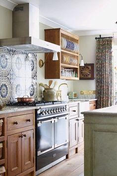 Discover the West London home of interior designer Louise Jones with the charm and comfort of an English country cottage on HOUSE - design, food and travel by House & Garden.