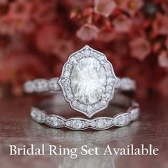 This vintage inspired moissanite engagement ring features a 8x6mm oval cut Certified Charles & Colvard Forever Brilliant Moissanite set in a solid 14k white gold floral setting and finished in a scalloped diamond band to enhance its elegance. ** The listing price is for ONE engagement ring only **  ............................................  ** Bridal Ring Set: https://www.etsy.com/listing/292830621/forever-brilliant-moissanite-engagement  ** Matching Wedding B...
