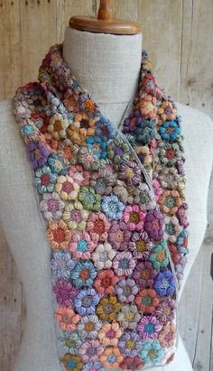 Colorful, tufty, little crocheted freesia blossoms, merino wool, about 6 x 40 inches.