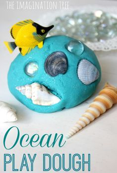 Ocean themed play dough recipe with loose parts like shells, gems, and plastic fish.  Such a simple way to bring the ocean to life for kids!