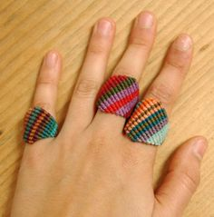 macrame rings.   got to study this!   kinda looks like friendship braclet - no instructions diy inspiration