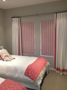 White curtains with fabric border designed by Ornella Botter Interiors.