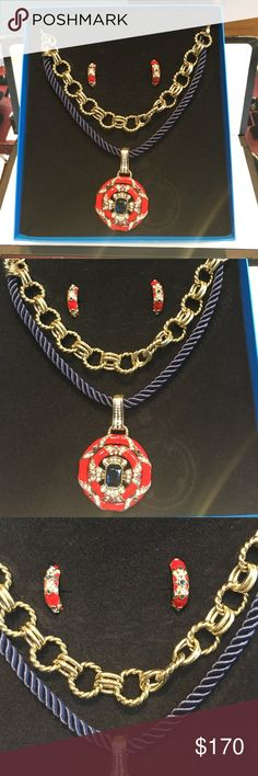 "Brand new Heidi daus 3pc necklace earring set Brand new Heidi daus red enamel necklace and earring set . The pendant is hallmarked heidi daus and comes with two necklace options . The earrings have clip backs . The pendant measures 3.0"" in length , the chains measure 19.0"" in length and the earrings measure 1.0"" in length . heidi daus Jewelry Necklaces"
