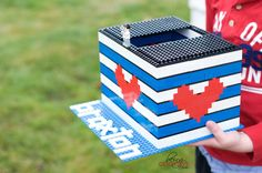 Lego Valentine Box | BeingGenevieve.com -- Are you in need of a Valentine school box idea?!?!? This valentine box is not only easy, adorable and FREE, but your little one can help with putting together the entire thing! Just grab all the legos around your house and start creating.