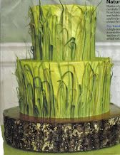 grasses and a wooden cake base.
