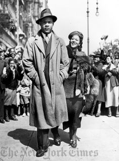 Joe Louis and his wife walking the streets of Harlem