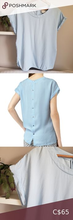 """Reiss Powder Blue Eleanor Button Back Blouse 8 Reiss """"Eleanor"""" short sleeve blouse top in light powder blue. Round neck, rolled-up short sleeves, notched side seams and curved hem. Exposed silver tone buttons down the back. A lovely, versatile and classic shape. Boxy fit. Viscose/lyocell blend. Size US 8 / UK 12 / EU 40. Length: 25"""" Width pit to pit: 20.5"""" Reiss Tops Blouses Teal Blouse, Black Lace Blouse, Pink Bandeau Bikini, Short Sleeve Blouse, Short Sleeves, Red And White Stripes, Printed Blouse, Powder"""