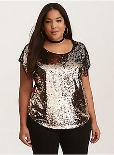 "The ultimate party top, this dolman pullover style has a surprisingly laidback fit considering how lit the all over gold sequins are. Best part? If you swipe up or down, the sequins change to black!     Model is 5'10"", size 1     Size 1 measures 27 3/4"" from shoulder  Polyester  Hand wash warm, dry low  Imported plus size top"